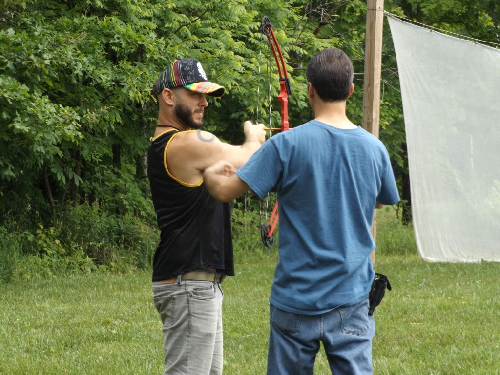 Campers learn to shoot archery.