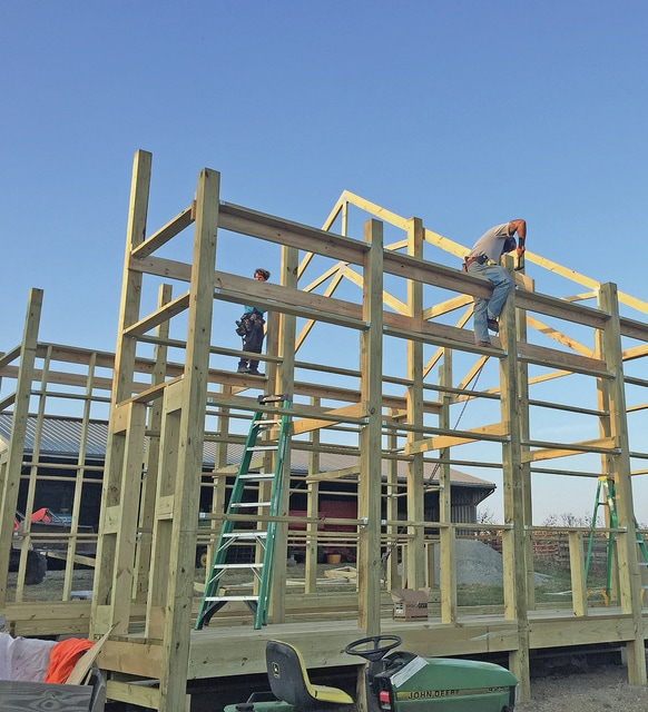 Cluff brothers building wooden corn crib just like their dad used