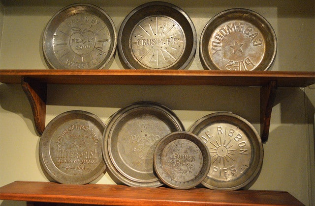 Kathy Levo shows off her unique pie pan collection