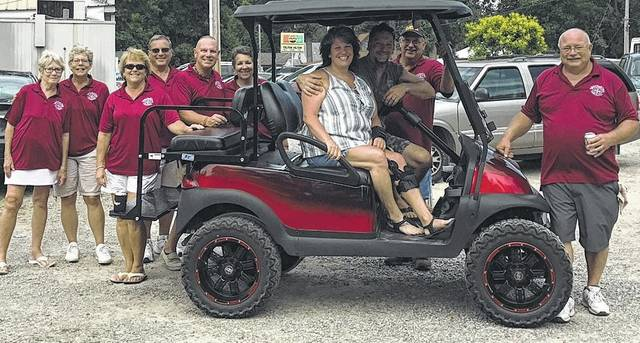 Teresa and Ralph Beherns of Lakeview won the drawing for a street-ready golf cart.