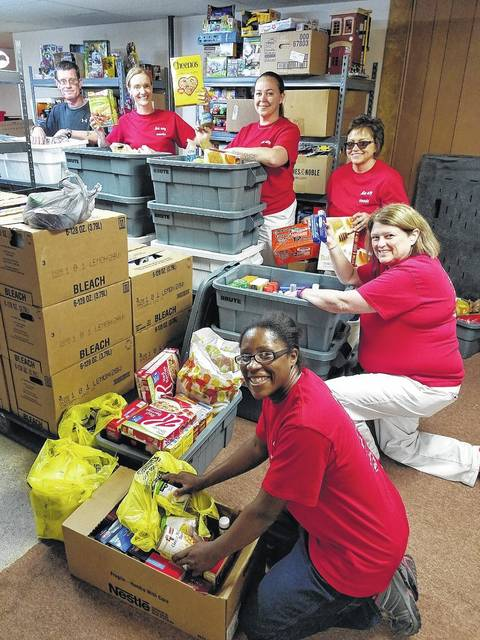 Associates from the East Liberty Auto Plant delivered and sorted more than a ton of food and personal-needs items collected during Honda of America, Manufacturing's first United Way Pantry Drive. A total of 2,400 pounds in donations will be used by families in need at Our Daily Bread in Bellefontaine. From left are Brandon Wickline of Our Daily Bread and HAM associates Carla Greene, Cassie Letner, Ginger Haynes, Sherry Roeth and Kristy Pearson. The Pantry Drive was a part of the Team Honda Week of Service. When combined with efforts from the Marysville Auto Plant and the Anna Engine Plant, HAM associates gave more than 10,000 pounds of needed pantry items.