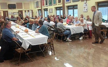 Indian Lake Interim Superintendent Rob Underwood speaks to the crowd during the Senior Citizens Appreciation Breakfast at Indian Lake Elementary School on Oct. 6.