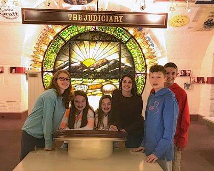 Indian Lake 8th graders, left to right, Lexi Lones, Kaitlyn Boberg, Cayden Nessler, Layla Yoakam, Nathan Worrell and Lane McPherson check out an interactive display at the Ohio Statehouse.