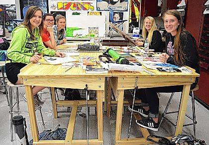 ILHS Art IV students Grace Weaver, Morgan Coppel, Mollie Swygart, Gianna Hagedorn and Jade Lewis use the new tables in the ILHS Art Room.