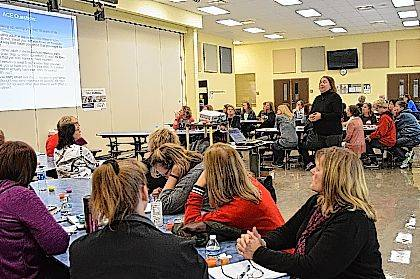 Richele Shepard explains ACE scores to staff at Indian Lake Local Schools during a recent professional development training.