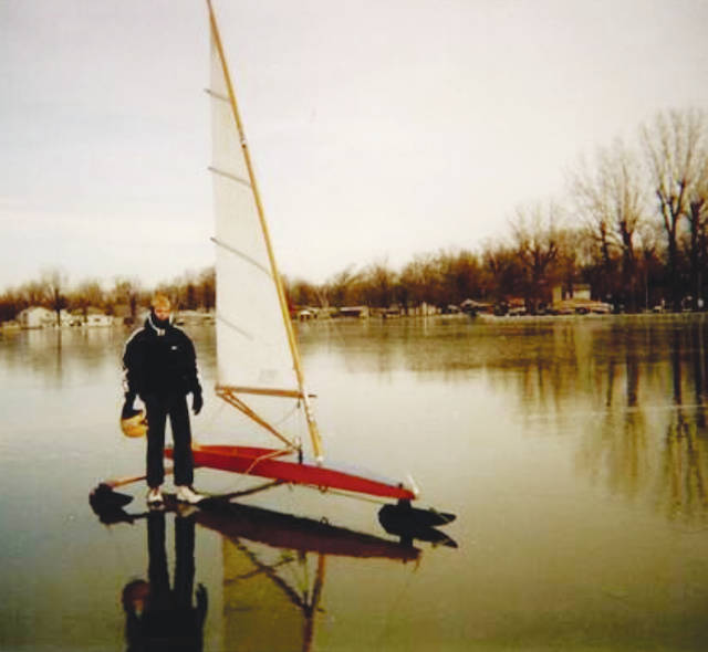 Brook Patten, son of Jeff Patten, is shown on black ice conditions at Indian Lake for perfect for ice sailing. Patten's DN class ice boat will glide at 50 mph in only 15 mph winds on black ice.