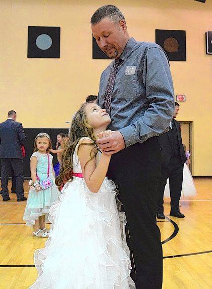 Third grader Lilly Michael dances with her father, John Michael of Huntsville, during Indian Lake Elementary's 5th annual Father-Daughter Dance.