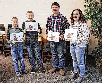 Indian Lake Middle School Students of the Month are, from left, 5th grader Kahne Ferguson, 6th grader Jordan Hutton, 7th grader Mark Wolf and 8th grader Callie Notestine. These students are chosen by their teachers and staff for demonstrating good citizenship, earning good grades and having a positive attitude. They receive a certificate, a homework pass, a pass to the front of the lunch line for a month, a free Cassano's pizza and an ice cream treat.