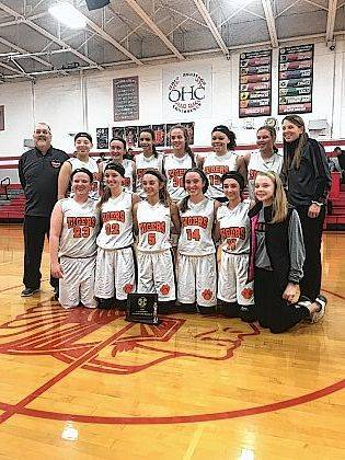 The West Liberty-Salem 8th grade girls basketball team won back to back OHC titles. They went 17-0 this season. Shown are Bella Kauffman, Aubree Williams, Megan Adams, Emily Hollar, Grace Winters, Aleah Reed, Coach Bruce Schlabach, Gabby Williams, Hallie Smith, Mandilyn Weaver, Naomi McGill, Braxton Givens, Kylee Francis and Coach Kim Hollar.