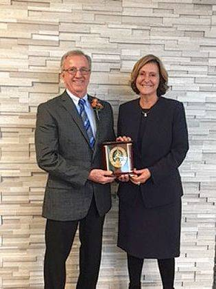Chuck Earick, 2018 Meritorious Service Award recipient, poses with Mandy Goble, Mary Rutan Hospital president and CEO.