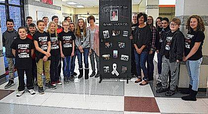 Middle school students pose with Kim Glock, her daughter, Mandy Oppy, and the latest Door of Encouragement: front from left, Colten Corcoran, Caiden Nicol, Halle Roby, Cameron Finfrock, Paige Mefford, Kim Glock, Mandy Oppy, Colby Borgerding, Madison Kidder, back from left, Ryan Culp, Easton Klauer, Landen Wisener, Colten Beair, Kaitlyn Shaner, Shania Fruchey, Reece Martin, Allison Kinney, Kendall Cotterman, Lindsey Bodi-Phillips and Cheyenne Hill.