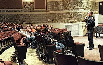 Washington Township Police Chief Rick Core talks to Indian Lake High School students about school threats.