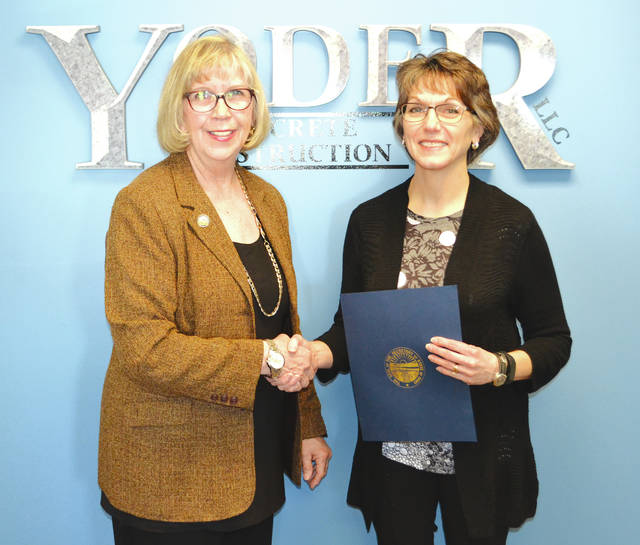 Yoder Concrete Construction CEO Roberta Yoder, right, received an Ohio Business Profile award from the Ohio Secretary of State's Office on Thursday. The state office's regional liaison, Elaine Herrick, left, visited the West Liberty business to present the award. Yoder has owned the company for 27 years. The award recognized her as a female business owner whose practices impact the regional economy.