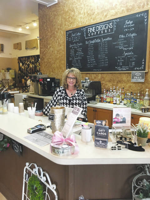 Melinda Peters Elliott, owner and proprietor of Fine Designs Coffees in London, features flavored coffees, specialized cappuccinos and fine chocolates.