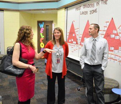 Indian Lake Elementary Co-Principal Molly Hall (middle) and Superintendent Rob Underwood lead State Board of Education member Linda Haycock (left) on a tour of the elementary school.