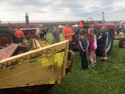 The West Liberty-Salem FFA chapter held the annual Elementary Ag Science Day on May 11. FFA members taught elementary students about agriculture. The students learned about farm animals, equipment and farming. The elementary students learned about horses, donkeys, chickens, steers, pigs, goats, sheep, alpacas, ducks and turkeys. At each station, chapter members shared information with the elementary students and allowed them to ask questions to better inform them about agriculture. The equipment included two tractors, a skid loader and a hay bine. The FFA members had a cookout that included past state FFA reporter Evan Callicoat. He joined in helping the students. Appreciation was expressed to Heritage Cooperative for allowing the group to use its gates.