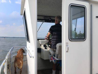 "Captain Toby and his trusty first mate ""Aslan"" tour Indian Lake."