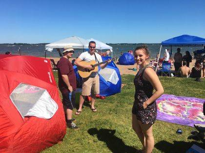 Backstage at this show was a beach. How cool is that? Singer-songwriter-guitarist Aubree McCurdy of Hilliard relaxes at the beach before taking the stage, while her dad, Shaun, tunes her guitar.