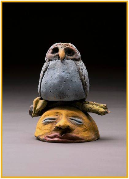 """Julie Byrne's """"Owl and Moon,"""" a 6-inch clay sculpture, is at the Muse Gallery, Columbus."""