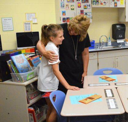 Third grade teacher Lisa Reese gives incoming third grader Karis Martini a hug during the Indian Lake Elementary Open House on Aug. 20. Hundreds of families attended Indian Lake's All Schools Open House Night.