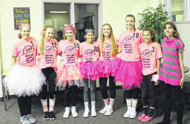 Members of the Indian Lake Middle School 8th Grade Volleyball Team pose for a picture in the Pink Out outfits they wore to school to promote the event. They are, from left, Stephanie Altstaetter, Jalan Martin, Elayna Richardson, Megan Kimbler, Paige Mefford, Allison Kinney, Reece Martin and Rachel Barnes.
