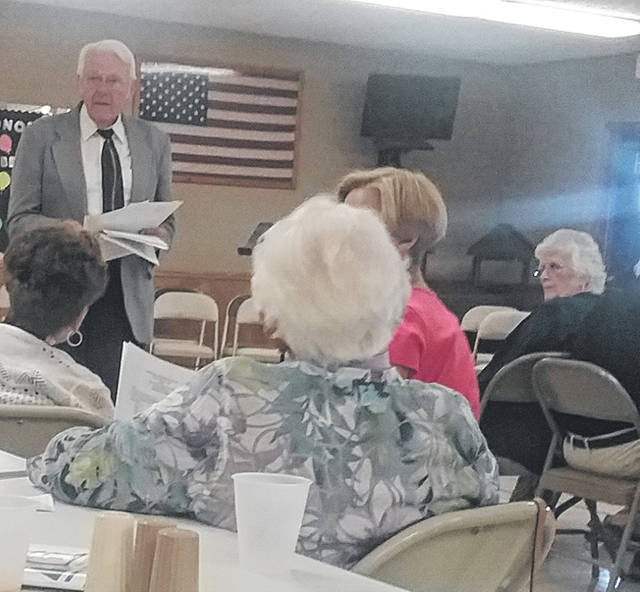 Emerson Brown, president, leads the August meeting of the Logan County Retired Teachers.