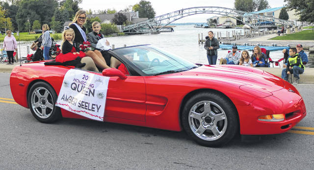 "Indian Lake Homecoming Queen Amber Seeley, driven by Chris Fulkerson, rides in style in the Oct. 4 Homecoming Parade. More than 35 floats made their way through downtown Russells Point as part of the 10th annual Indian Lake Homecoming Community Parade and Pep Rally. The theme was ""If you can dream it, you can do it."" The floats all featured a Disney movie. Queen Amber and members of the court were introduced. The ILHS Cheerleading and Marching Band led a pep rally in the McDonald's overflow parking lot following the parade. Indian Lake hosts the Graham Falcons at Laker Stadium today. Pregame festivities begin at 6 p.m."