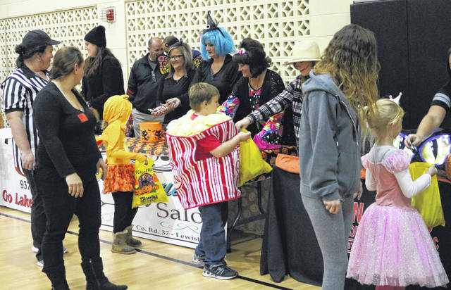 Jodi Miller, Carrie Brown and Ginger Kimmel from Tranquility Salon hand out candy.