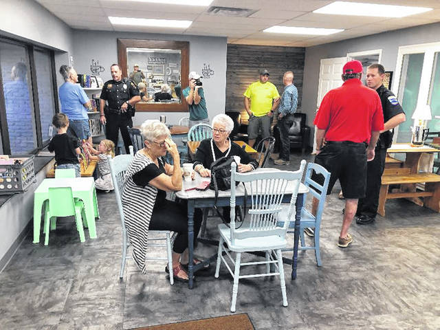 Coffee with a Cop was held at the Gathering Grounds.