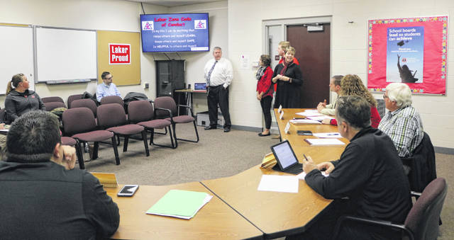 Indian Lake Elementary School's PBIS team members Co-Principal Jeff Reprogle, Suzy Mallory, Justin Welker and Pam Scarpella present to the Indian Lake Board of Education in November.