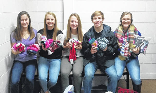 The Class of 2021 collected 400 pairs of socks during a Sock Drive at Indian Lake High School. Sophomores learned that socks are the least donated clothing item and yet the most in demand for those in need. The class organized a drive through Lake Time classes. Mr. Metzger's Laker Time class donated the most, with 229 pairs collected. The socks will be donated to the United Christian Services Food Pantry of Indian Lake for distribution throughout the winter. Pictured are sock counters, from left, sophomores Raelyn Parsell, Ella Wagner, Ashlyn Shaner, Lane Mefford and Allix Cotterman.