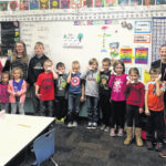 Church youth group helping young readers