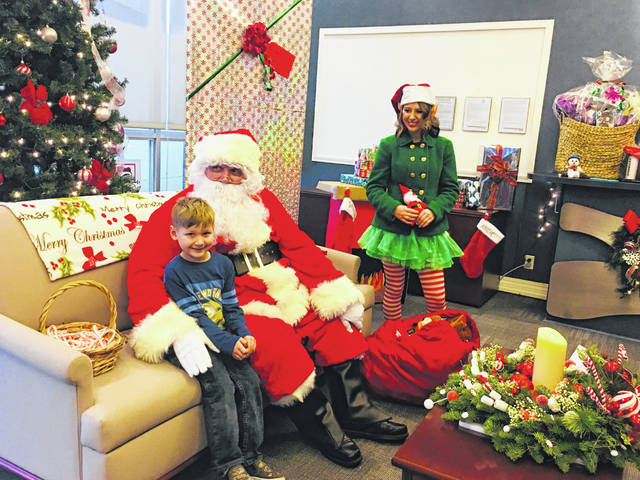 Santa met many kids at the Christmas Extravaganza this past weekend in downtown Lakeview. One of Santa's elves, who helped make all the toys in his workshop, was on hand as well.