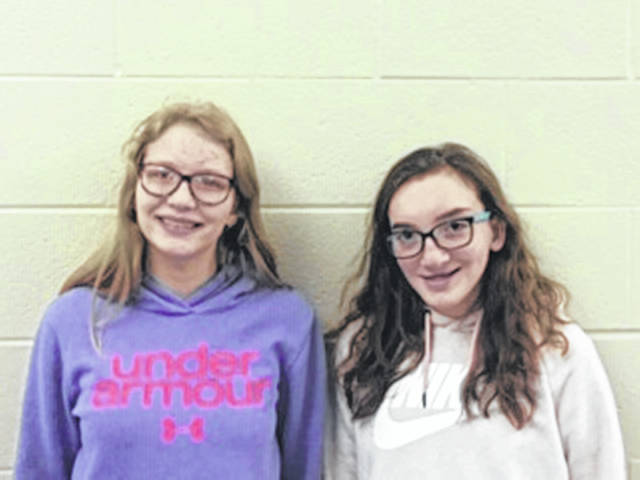 Getting top marks in Riverside's junior high spelling bee were, from left, Aubree Davis and Siera Barhorst.