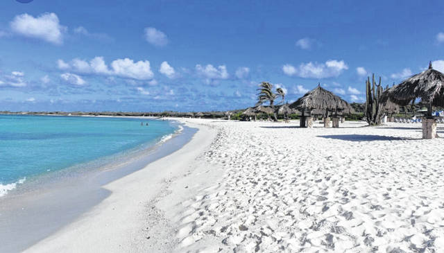 Indian Lake this summer? Why not? Just add sugar white sand and build a few tiki huts and both Old Field Beach and Fox Island Beach could look just like this. And, they would be shark-free and salt-free.