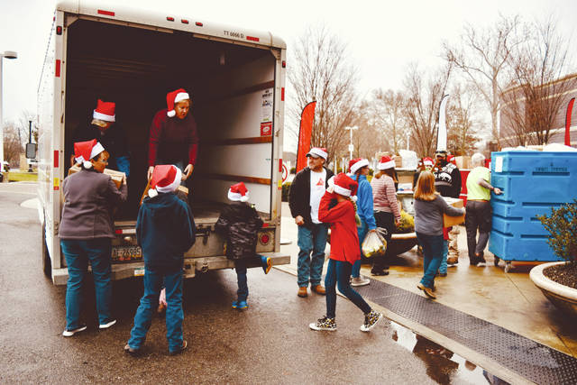 A large U-Haul truck donated by JR and Nina Lane of Lane Lube Express of Bellefontaine hauled toys to the hospital. The Lanes not only donated their truck, but also helped load, unload and drive the truck.