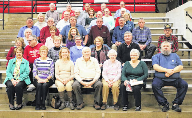 Members of the classes of 1969 and 1970 and former staff members gather on the original bleachers in the ILHS Main Gym.