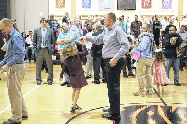 Jeremy Kaser of Huntsville spins his kindergarten daughter, Ivy, during the Father-Daughter Dance.