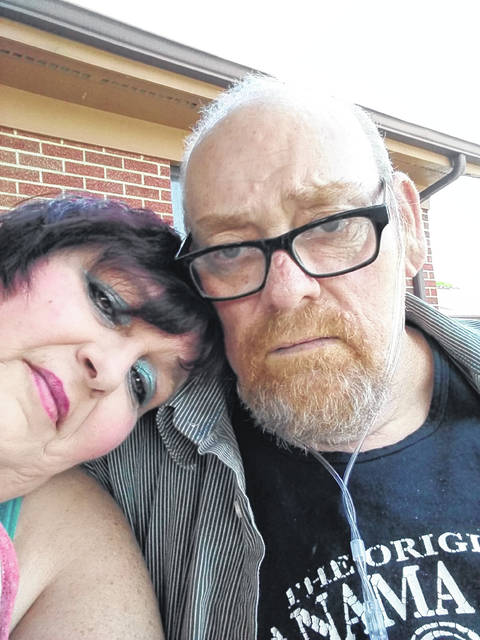 Robert Erwin of Indian Lake poses with friend and caregiver Glennia Milonich.