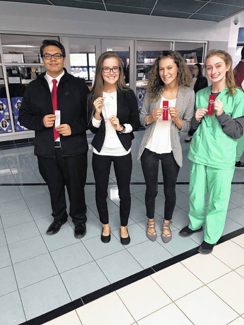 HOSA State qualifiers from the Allied Health and Nursing satellite program include, from left, Orlando Marcos, Bailie Clark, Peyton Preston and Kylie Allmon.