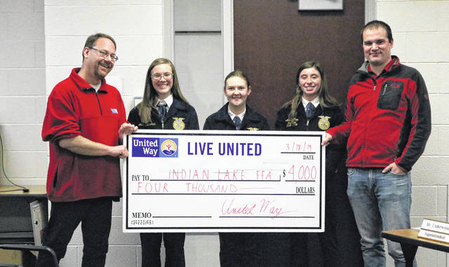 From left are United Way Director Dave Bezusko, Allix Cotterman, Nikita Scheifele and Alexis Clem of OHP/ILHS FFA and FFA Advisor and Ag Educator Tanner Schoen.