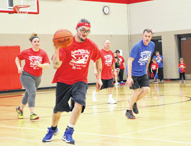 Oscar Dodds dribbles the ball up the court after pulling down a rebound in the third annual Community Outreach Basketball Game.