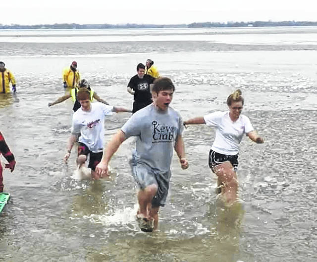 Indian Lake High School Key Club members Nate Reichert and Amber Seeley dash though frigid waters during the Indian Lake Polar Plunge. Club members braved the freezing water to support Special Olympics. Key Club President Amber Seeley alone raised $125 for the March 9 Special Olympics of Ohio 2019 Indian Lake Polar Plunge. The other students who participated were Cole Overbey, Nate Reichert, Kason Carruthers, Kassidy Crockett and Mackenzie Garver. In total the club raised almost $400 to support Ohio Special Olympics. Overall, the event raised nearly $3,000. Prior to the plunge, fire and rescue officials had to break up ice so plungers could enter the water!