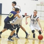 Defenders shock Wellston in OT, 77-66