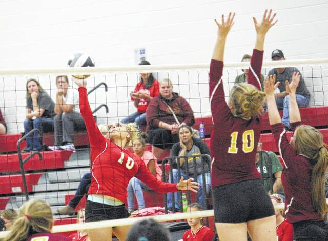 South Gallia's Aaliyah Howell, left, goes up for a kill attempt over Federal Hocking's Paige Watkins during Monday night's Tri-Valley Conference Hocking Division volleyball match in Mercerville, Ohio. (Paul Boggs|OVP Sports)