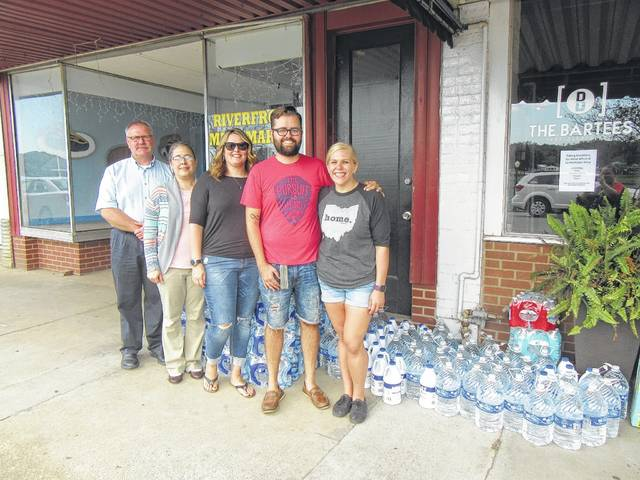 Local residents, business and organizations are coming together to send truck loads of donations to Florida as the residents of the state work to recover from the effects of Hurricane Irma. Pictured are (from left) Larry Byer and Terri Ingels of Meigs County Department of Job and Family Services, Pam Patterson and Brandon and Rana Bartee.