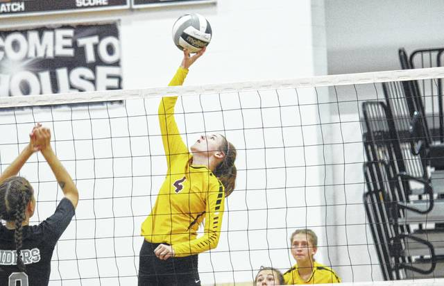 Meigs senior Paige Denney (4) goes up for a kill attempt during the Lady Marauders' Tri-Valley Conference Ohio Division volleyball match against River Valley on Tuesday night in Bidwell, Ohio.
