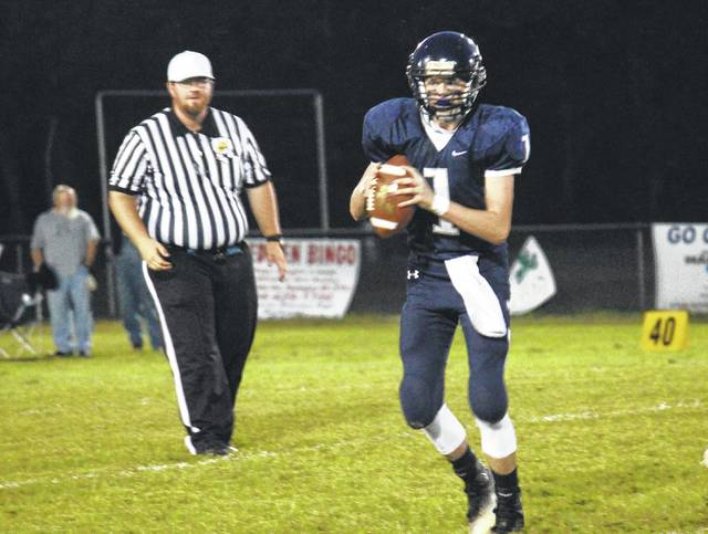 Hannan quarterback Matthew Qualls (1) looks for an open receiver during the Wildcats' football game against Manchester on Sept. 8 at Hannan High School.