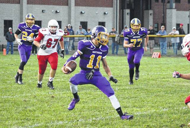 Southern junior Logan Drummer (11) makes a move against a Wahama defender in front of Tornadoes Garrett Wolfe (24) and Austin Arnold (77) as well as White Falcon Christopher Hesson (67) during Friday's SHS victory in Racine, Ohio.