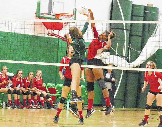 Point Pleasant junior Lanea Cochran (11) blocks a dink attempt by a Winfield player during Game 1 of Thursday night's match in Winfield, W.Va.